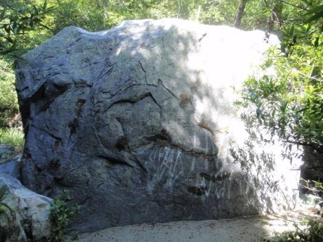 "Look closely and you will see where the land owner has smeared axle grease on the climbing holds of this classic Baldy boulder. Some idiot tagged the word ""fag"" below. This is the area where the famous Goat Roper climb is. The land owner has fought with climbers about access for a long time."